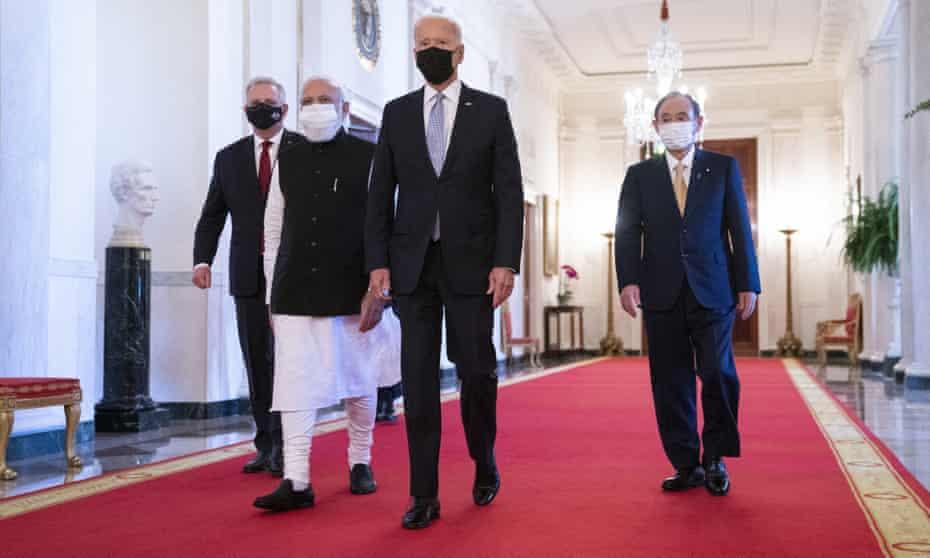 Joe Biden walks with, from left, Australian prime minister Scott Morrison, Indian prime minister Narendra Modi, and Japanese prime minister Yoshihide Suga, in the East Room of the White House.