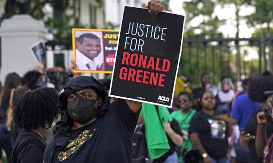Demonstrators stand in front of the governor's mansion in Baton Rouge, Louisiana, on 27 May 2021 protesting the death of Ronald Greene, who died in the custody of state police in 2019.