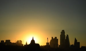 The sun rises behind a view of St Paul's Cathedral