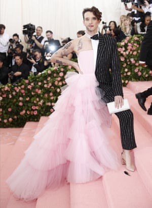 US actor Michael Urie in a pinstripe suit/pink tulle strapless gown combination created by Christian Siriano