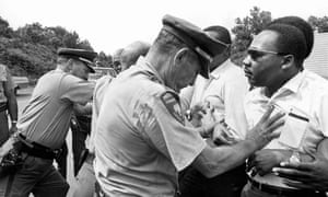 Martin Luther King is shoved back by Mississippi patrolmen during the 220-mile 'March Against Fear' from Memphis, Tennessee to Jackson, Mississippi.