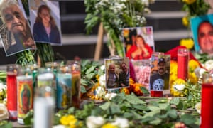 Photos of some of the deceased are seen at a memorial ceremony held by loved ones of mostly Latino essential workers who are among the more than 5,700 Angelinos who have died of Covid-19 in Los Angeles, California.
