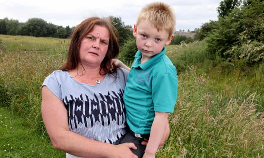 Rebecca Currie with her son, Mathew Richards, five, who live near the landfill site in Silverdale, Staffordshire