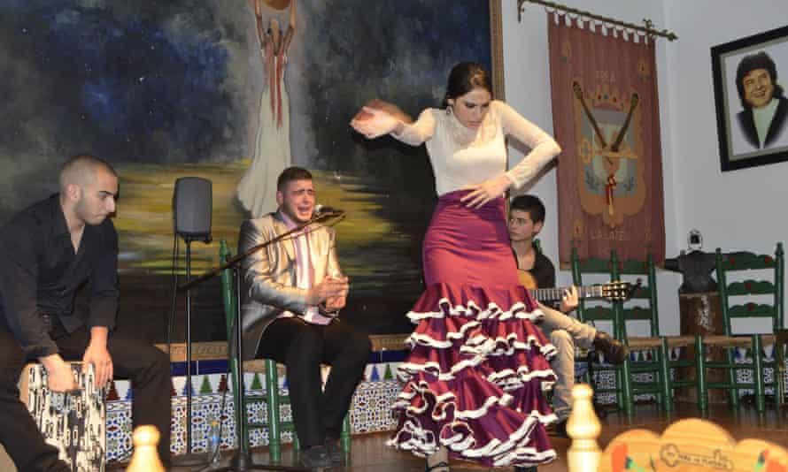 Female flamenco dancer and backing band at Peña La Platería flamenco club, Granada, Spain