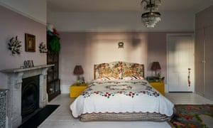 Calm and serene: chandeliers, painted floor boards and bright covers in the bedroom.