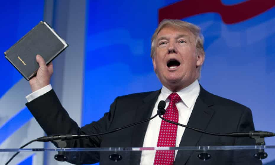 Donald Trump holds up a Bible at a speech in Washington