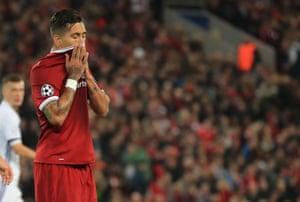Liverpool's Roberto Firmino looks dejected.