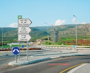 Road sign pointing to Nazareth and Kafr Kanna