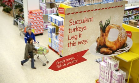 An advert for turkeys hangs from the ceiling at a Tesco Extra supermarket