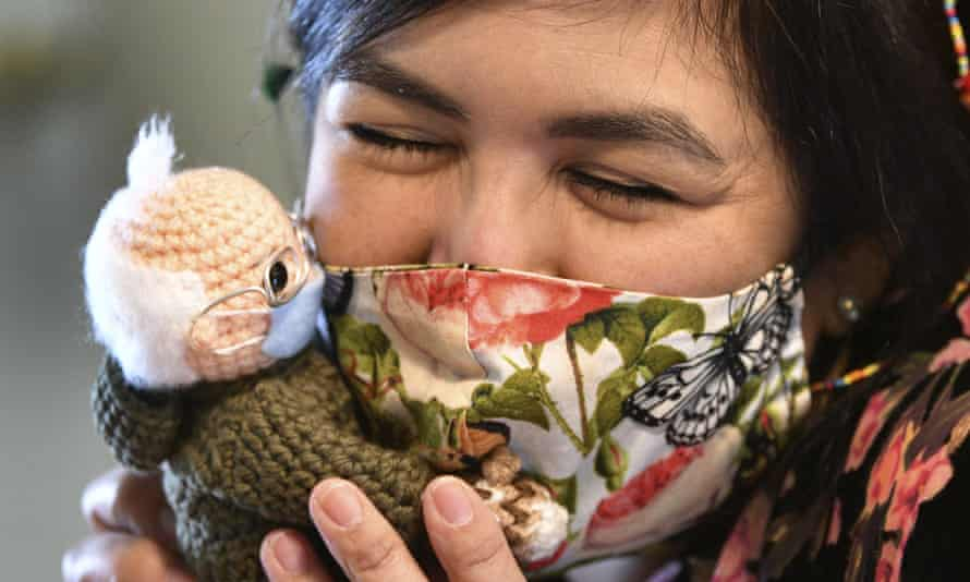 Tobey King, of Corpus Christi, Texas, embraces the crochet Bernie Sanders doll that she made and sold on eBay for $20,300.