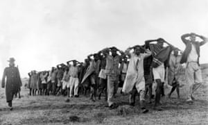 A photograph showing a round up of Mau Mau suspects in Nairobi, Kenya, in 1952.