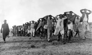 Mau Mau suspects are led away for questioning by police in the Great Rift Valley in Kenya in 1952, during the rebellion against white colonisation.