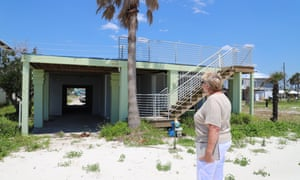 Linda Albrecht stares up to the second floor of her former home, which was ripped away by Hurricane Michael more than seven months ago.