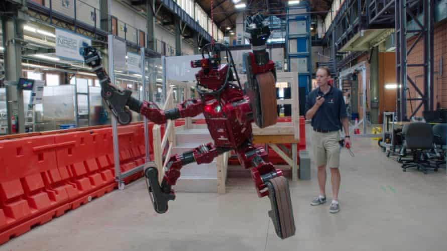 a robotics researcher at work, in Lo and Behold