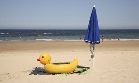 Yellow Inflatable Duck on Comillas Beach, Cantabria, Spain