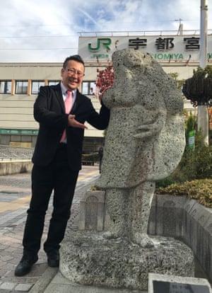 Akihiro Suzuki, secretary general of the Utsunomiya Gyoza Association, next to the Gyoza Venus statue