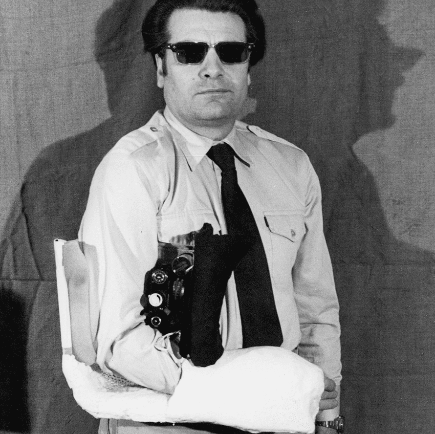 A Stasi agent demonstrates a camera disguised as an arm cast in East Berlin in 1982