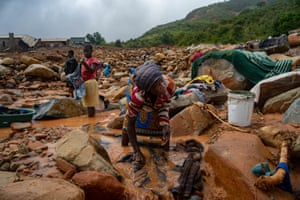 Chimanimani, Mozambique. An elderly woman washes her belongings in the mud after the area was hit by the Cyclone Idai. More than a thousand people are feared to have died