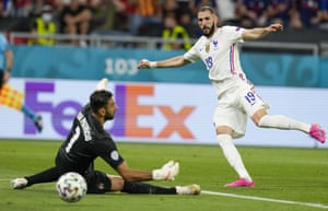 France's Karim Benzema, right, kicks the ball past Portugal's goalkeeper Rui Patricio to score his team's second goal.