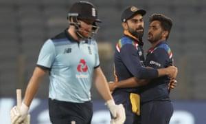 England's Jonny Bairstow trudges off the pitch as India's captain Virat Kohli (centre) celebrates his dismissal with Shardul Thakur.