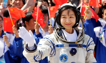 Liu Yang, China's first female astronaut, waves during a departure ceremony before becoming the first Chinese woman in space in June 2012.