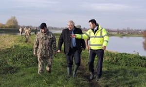 Boris Johnson with Lt Col Tom Robinson of the Light Dragoons and Oliver Harmar, Yorkshire area director of the Environment Agency as he visits Stainforth