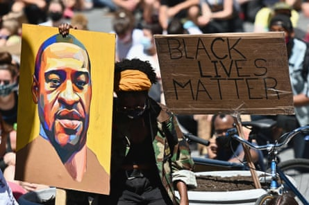 Protesters hold up a portrait of George Floyd at a Black Lives Matter protest in New York, 8 June.