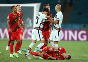 Pepe of Portugal clashes with Jan Vertonghen of Belgium after fouling Thorgan Hazard.