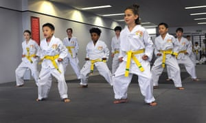 An intermediate group in one of Busuttil's taekwondo classes.