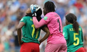 Aurelle Awona of Cameroon is consoled by goalkeeper Annette Ngo Ndom after she scores an own goal.