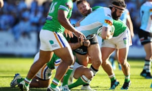 Aaron Woods is tackled during the Cronulla Sharks and the Canberra Raiders on 1 September. Woods lines up for Cronulla on Sunday, despite having a Leichhardt postcode tattoo.