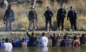 Demonstrators protest against the expansion of the Dakota Access pipeline in cold creek waters near Cannon Ball, North Dakota, on 2 November 2016.