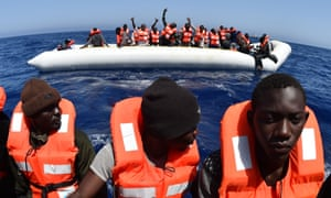 Refugees are rescued off the coast of Libya last May.