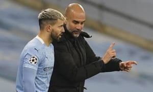 Pep Guardiola gives instruction to Sergio Aguero.