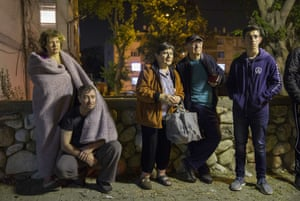 Israelis stand outside their building after it was hit by a rocket fired from Gaza in the costal city of Ashkelon.