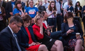 Supporters of the 'Stronger In' Campaign react as results of the EU referendum are announced at a results party at the Royal Festival Hall in London early in the morning of 24 June