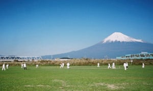 Cricket being played in the foreground of Mount Fuji, Japan.