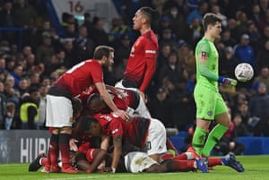 Paul Pogba is mobbed after scoring for Manchester United in the win over Chelsea.