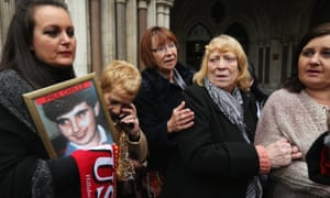 Families outside the high court in London on 19 December 2012 after the first verdict was quashed.