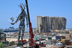 Beirut, Lebanon. Workers install a monument inside Beirut port as a remembrance for the victims killed and injured in last August's harbour explosion