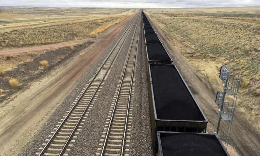 A train hauls coal mined from Wyoming's Powder River Basin. President Trump's lifting of a federal coal leasing moratorium issued last year by Barack Obama will allow new leasing of federal coal to resume.