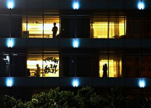 Guests stand at hotel room windows in Jakarta, Indonesia