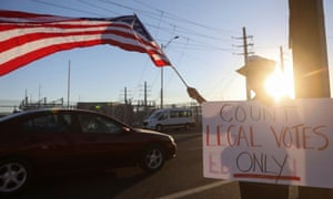 A Trump supporter holds a sign reading 'count legal votes only' in Phoenix, Arizona, on 11 November.