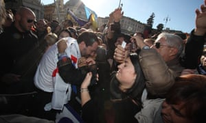 Lega supporters embrace the party leader, Matteo Salvini, at an anti-EU protest in Rome.