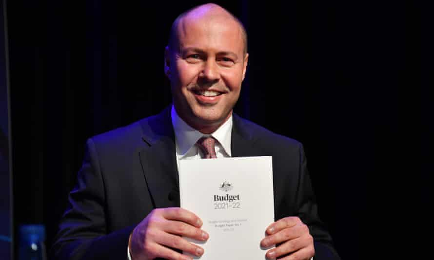 Federal Treasurer Josh Frydenberg holds a copy of the 2021-2022 Federal Budget before he delivers his budget address at National Press Club, in the Great Hall at Parliament House on May 12, 2021 in Canberra, Australia.