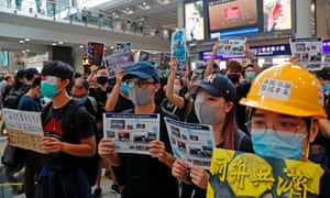 Protesters at Hong Kong's international airport wear eye patches during a mass demonstration in tribute to fellow protester shot in the eye.
