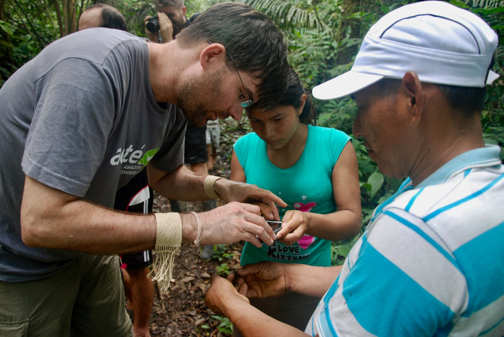 Segundo, Acaté's president Christopher Herndon and Matsés woman Casilda Jiménez working on the pilot herpetological inventory near Estirón village. Photograph: Acate Amazon Conservation
