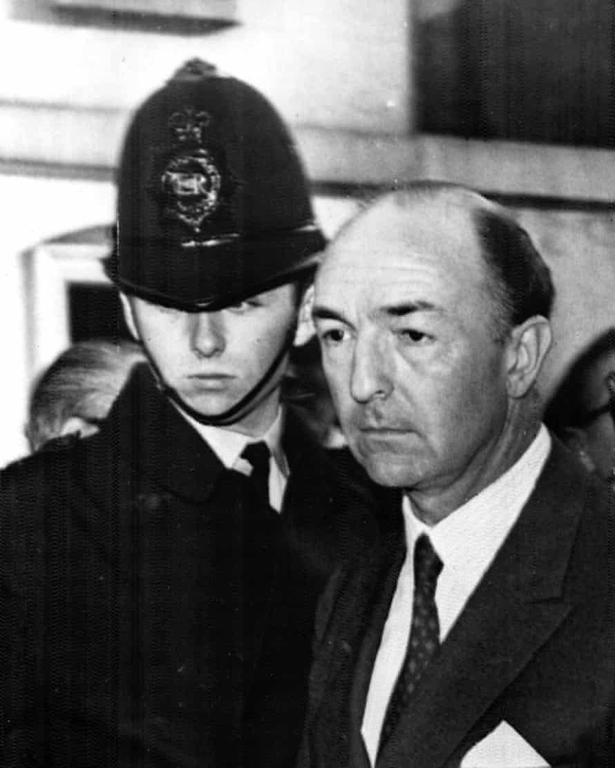 John Profumo and a police officer