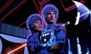Part of the poster for TRON, the joyous 1982 film set in a grid.