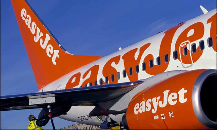 an Easyjet plane being refulled on the tarmac
